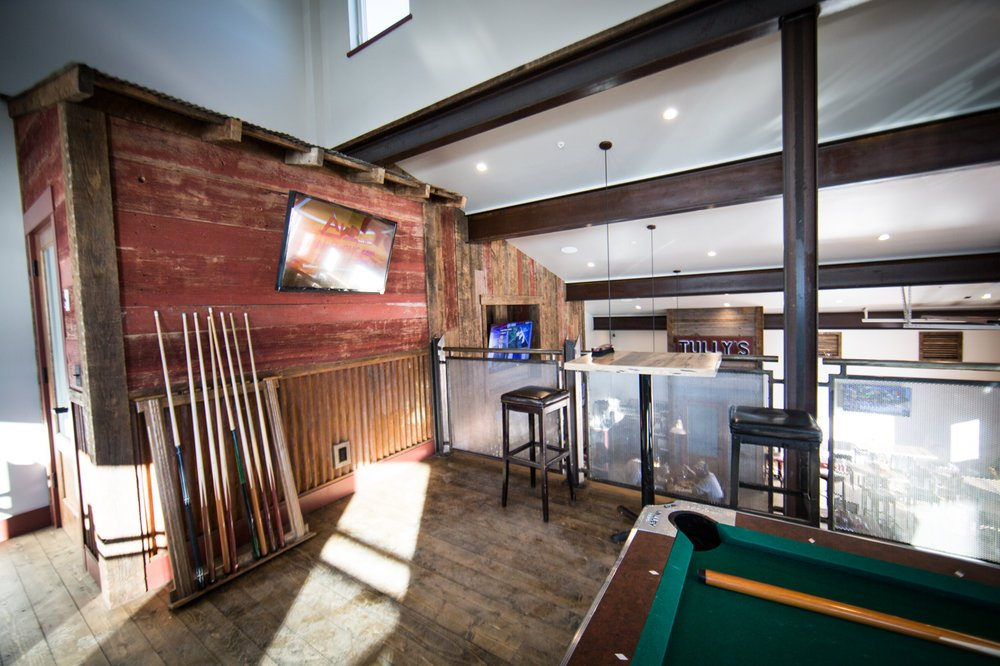 Tully's pool cues and tv