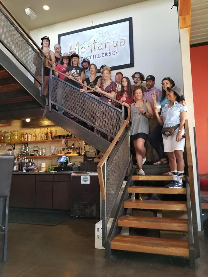 Montanya staff on stairs