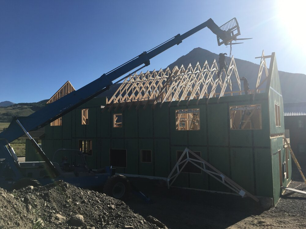putting roof on a house under construction