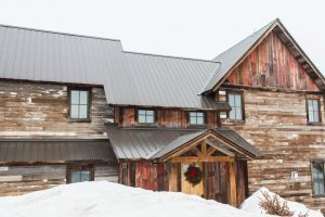 Reclaimed wood home in the snow