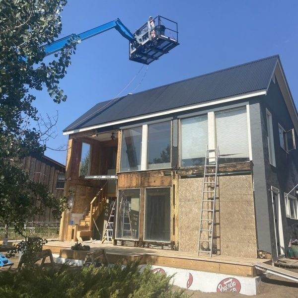 house under construction with crane